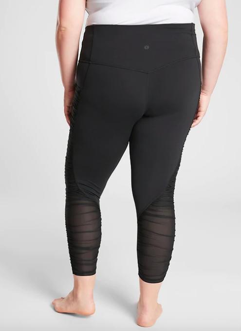 Model wears mesh black leggings with panel detailing on the calves