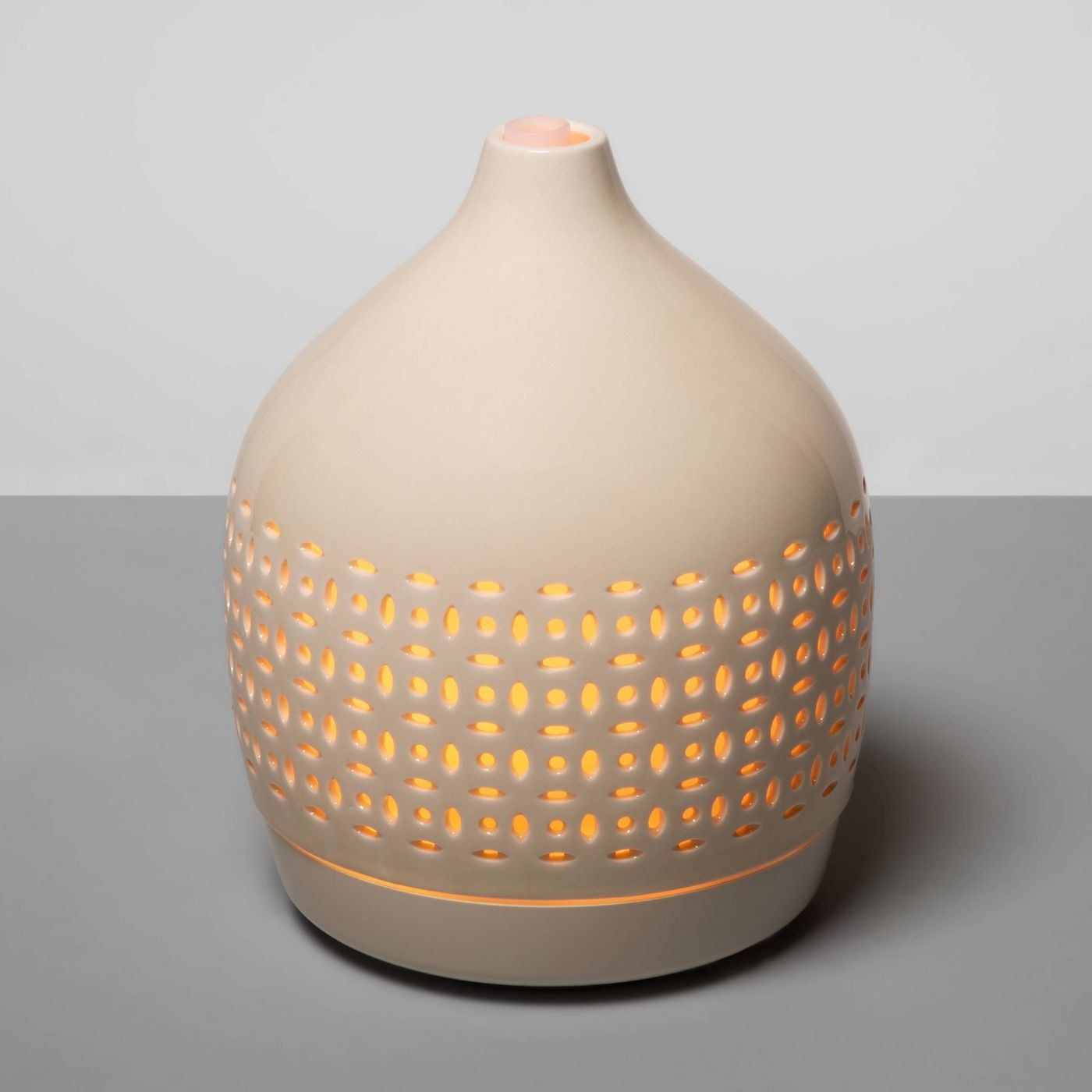 The essential oil diffuser glowing orange