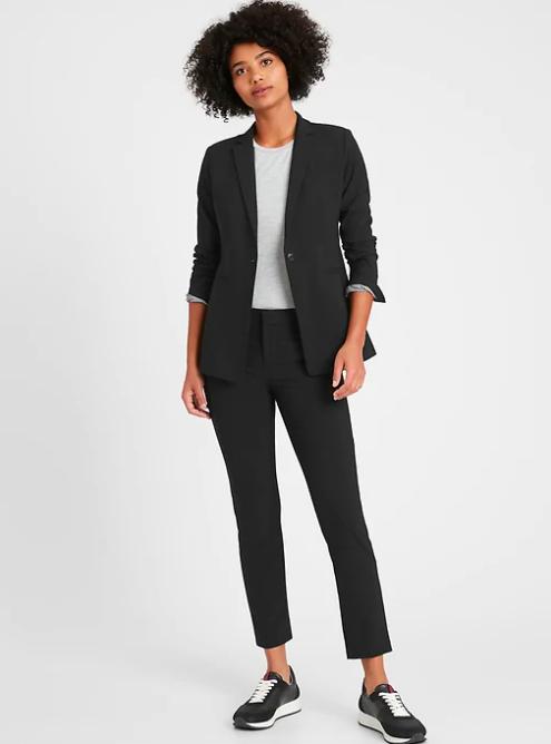 a model wearing the blazer in black