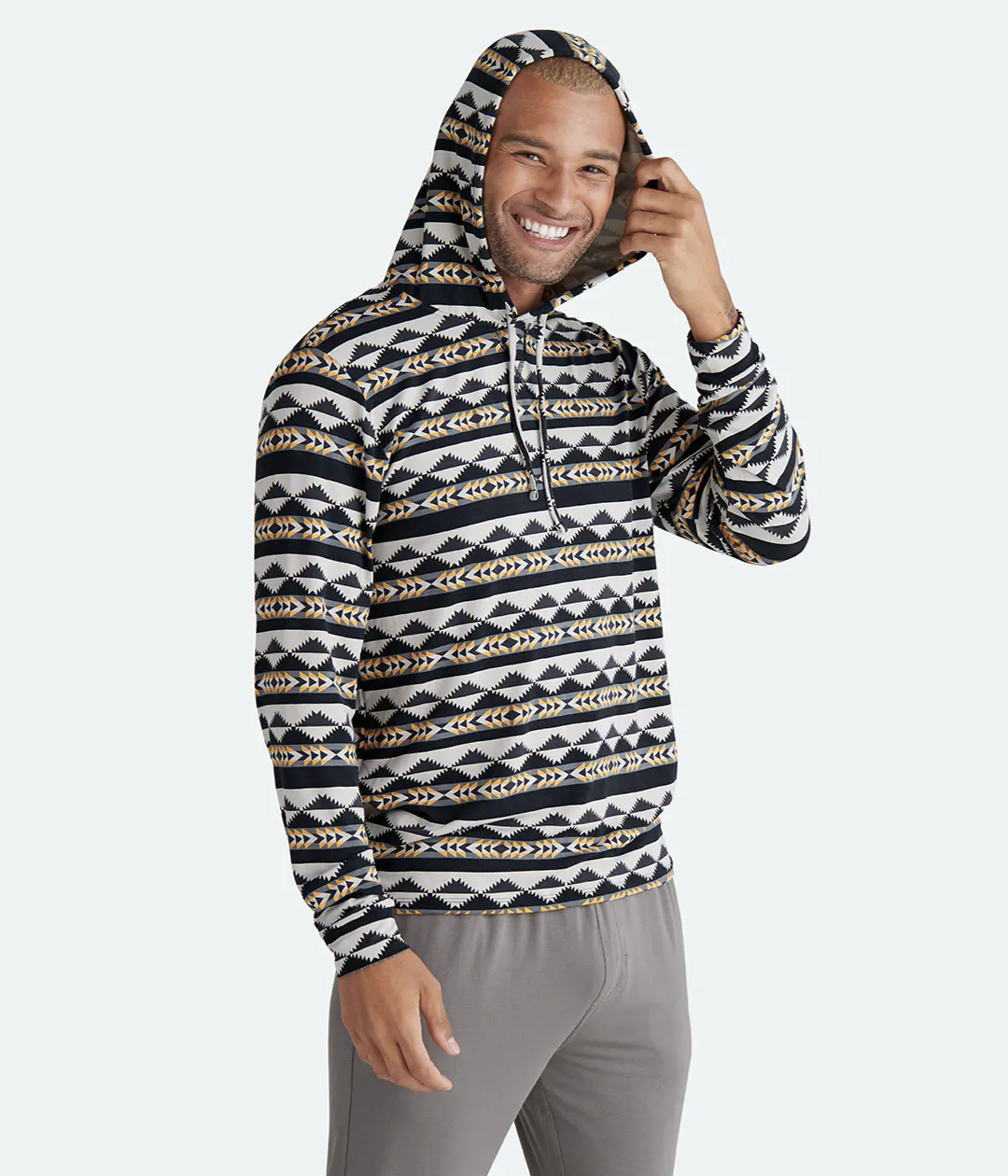 model wearing the black, gray, white, and yellow geo hoodie