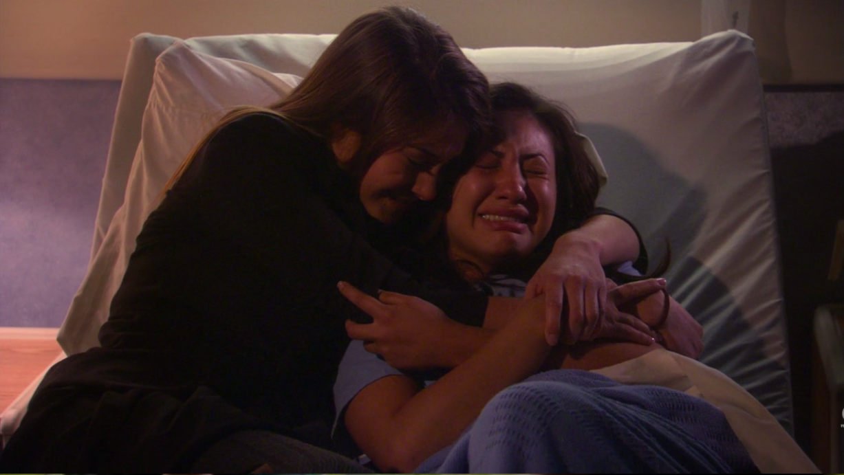Amy consoles a devastated Adrian