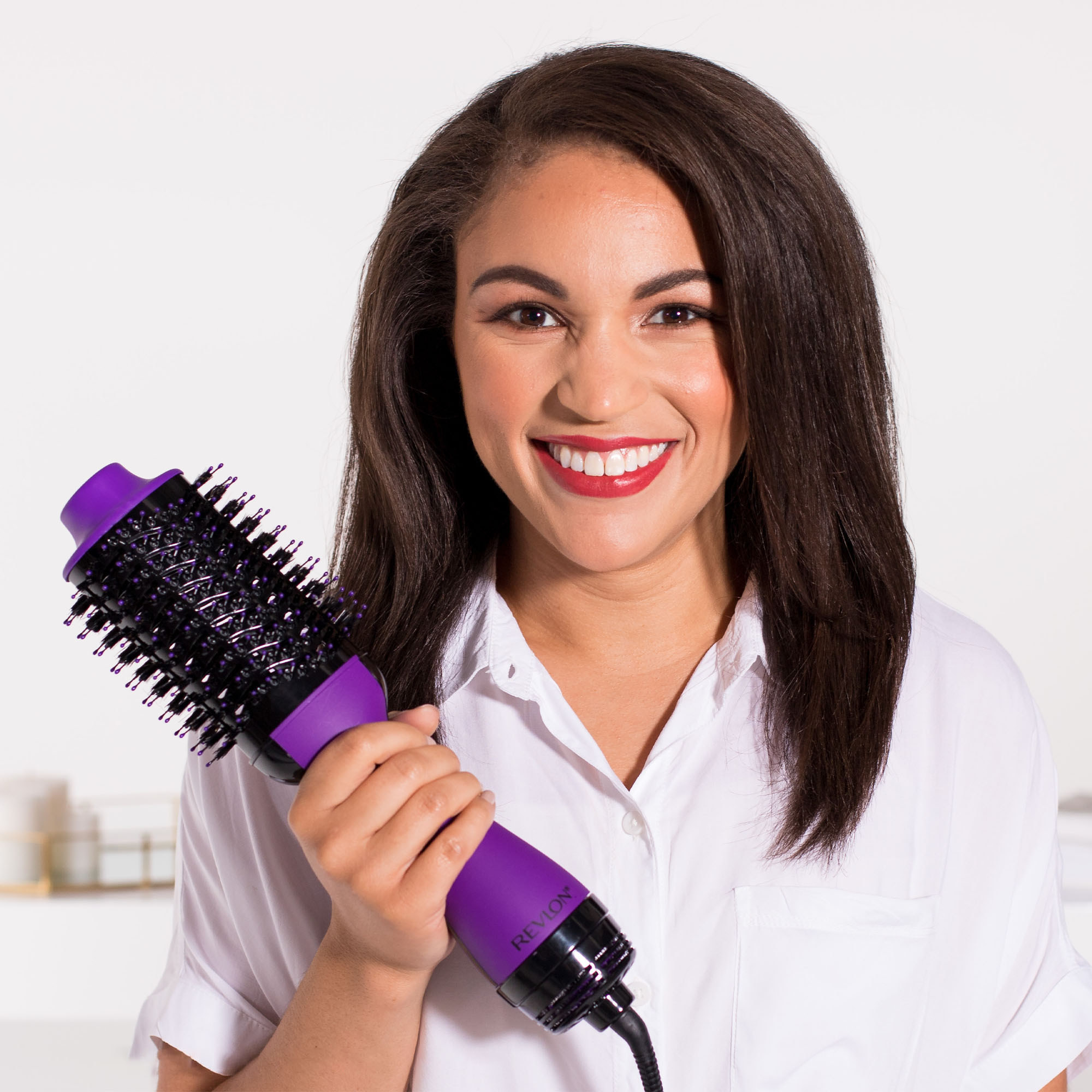 Model holding the dryer brush