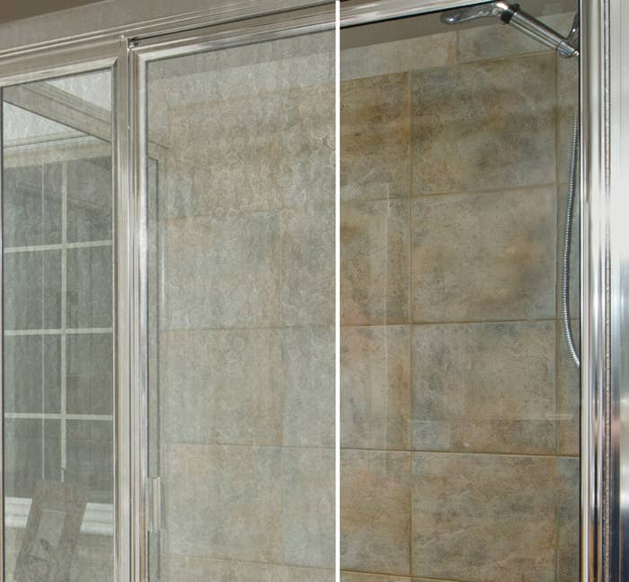 A shower door, one side covered in soap scum, and the other side cleaned and clear
