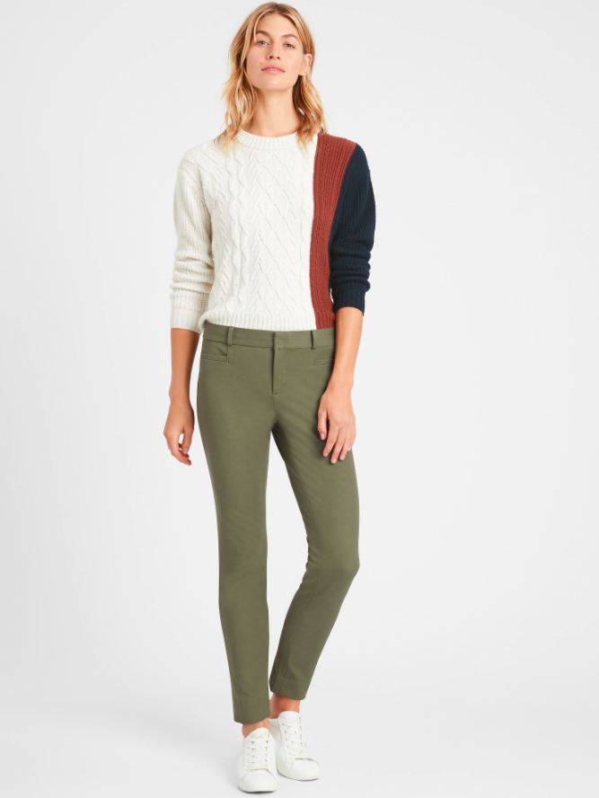 a model wearing the pants in green