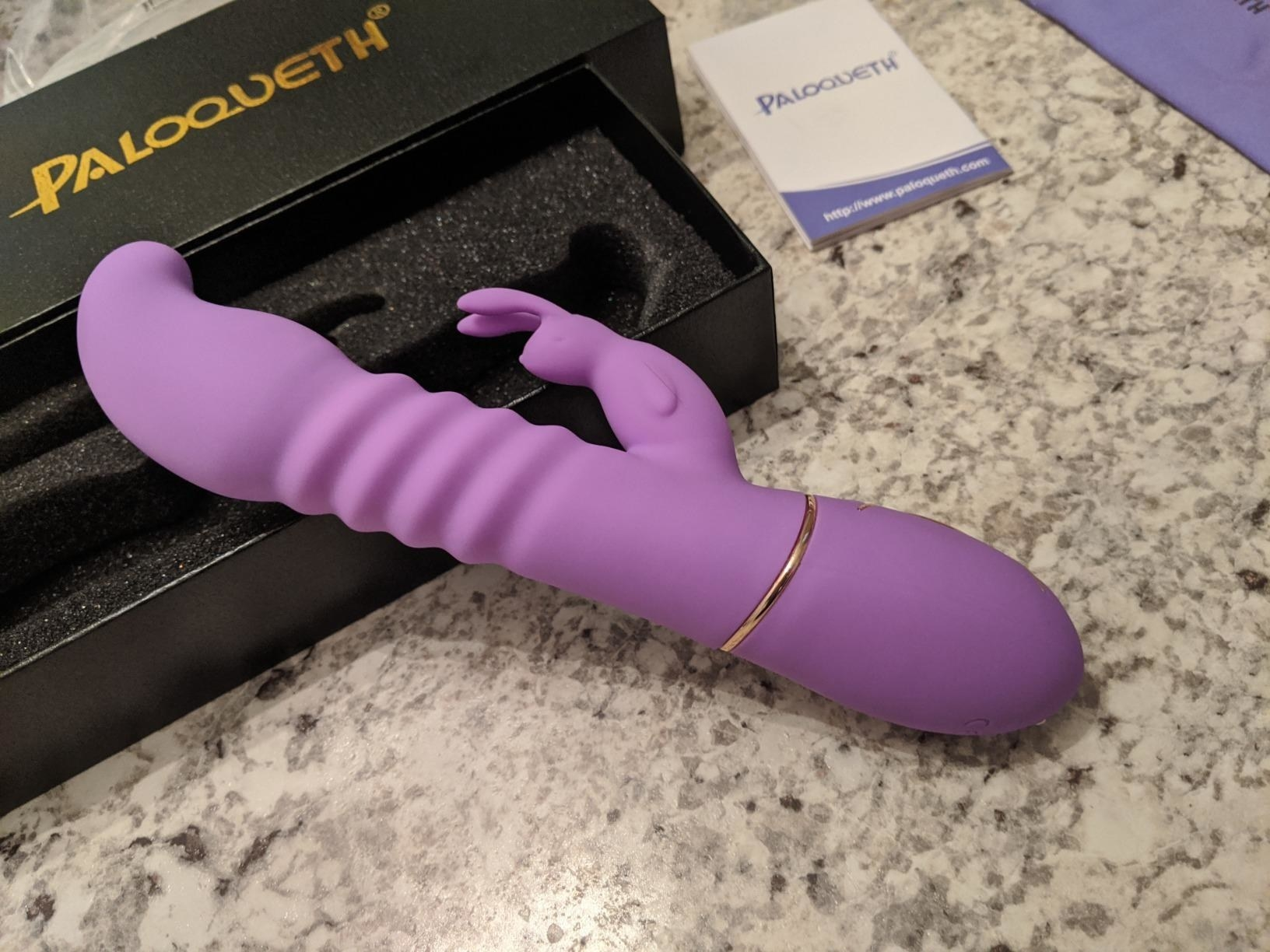 The PALOQUETH Thrusting Rabbit Vibrator and its packaging on a customer's countertop