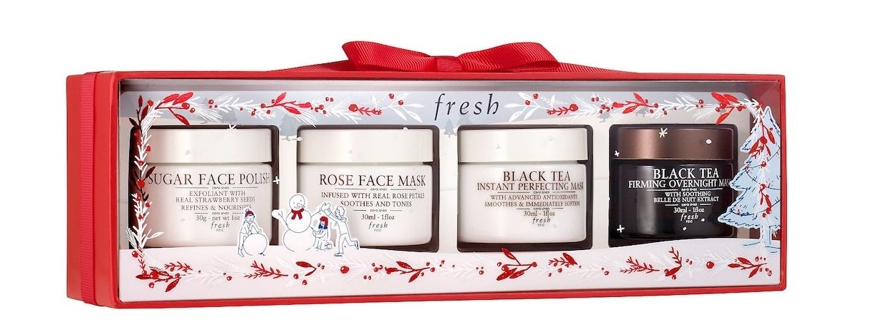 Four masks in holiday-themed packaging