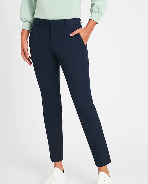 a model wearing the pants in navy