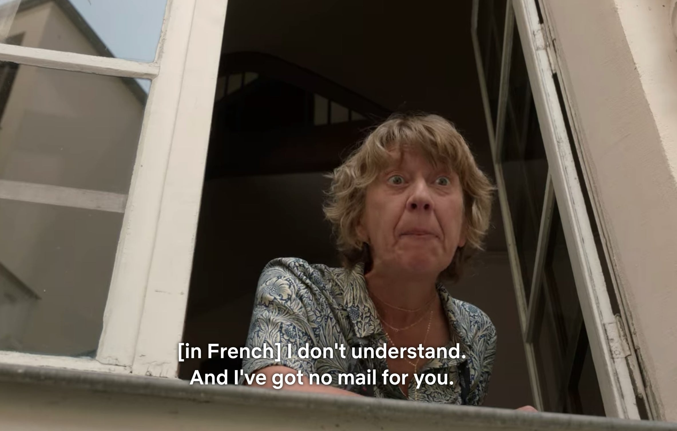 "An old French woman looking out her window and saying ""I don't understand. And I've got no mail for you."""