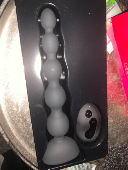 The KUUVAL Waterproof Anal bead G-spot Vibrator in its packaging in a customer's home