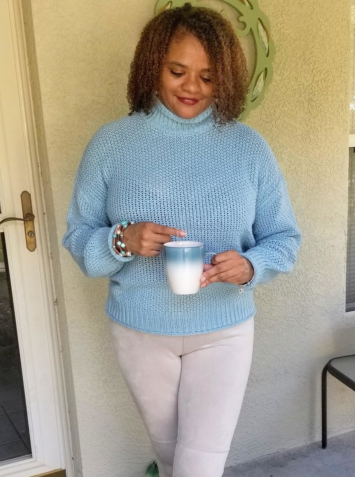 Reviewer wearing the turtleneck in light blue