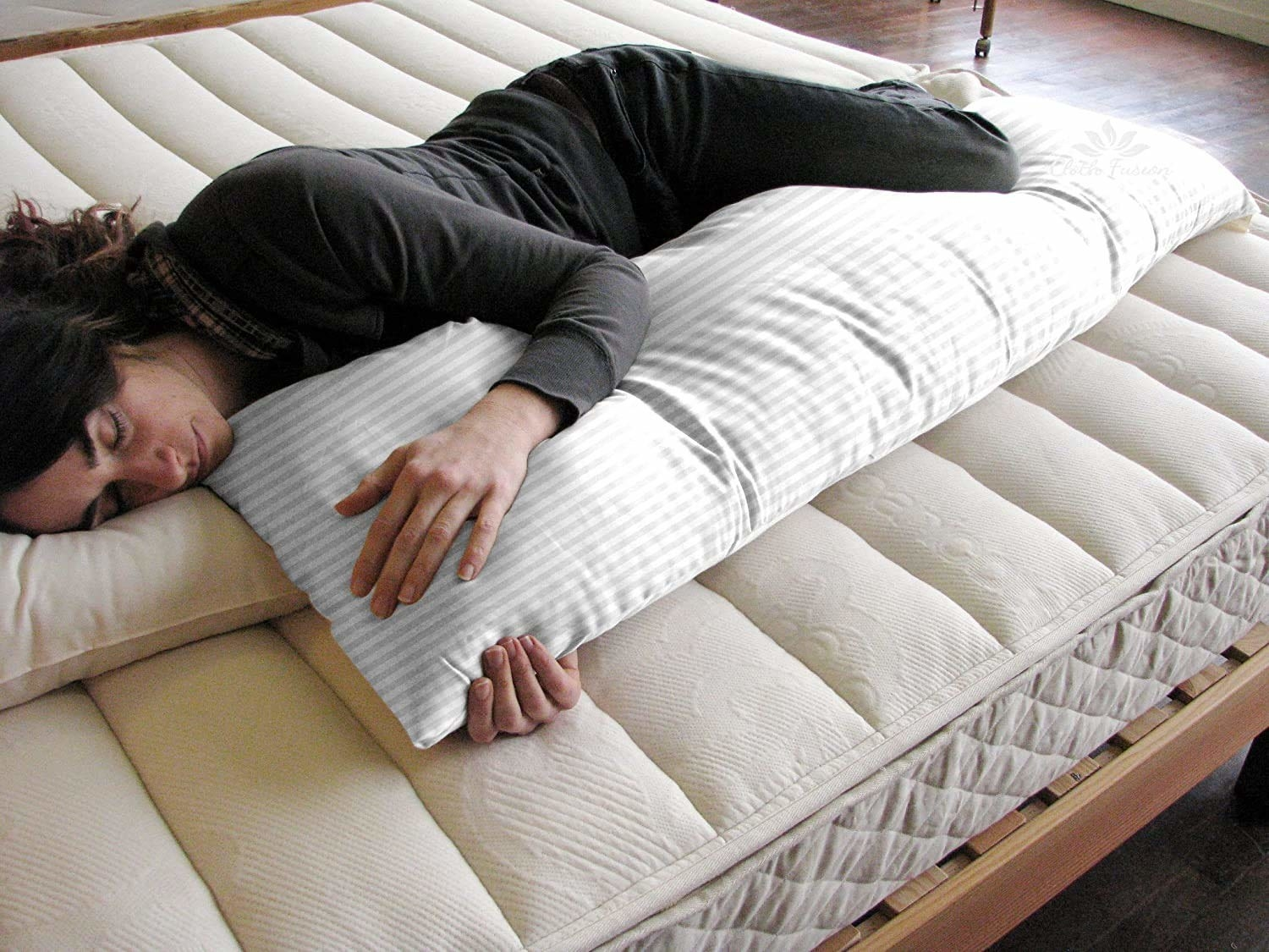 A sleeping person hugging the body pillow.