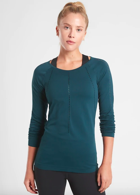 Model wears teal long-sleeve workout top with gray leggings