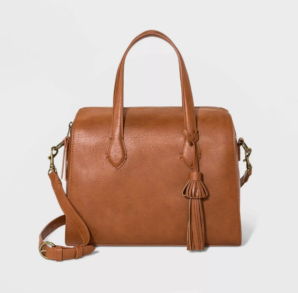 Tan satchel bag with handles, tassel and long strap