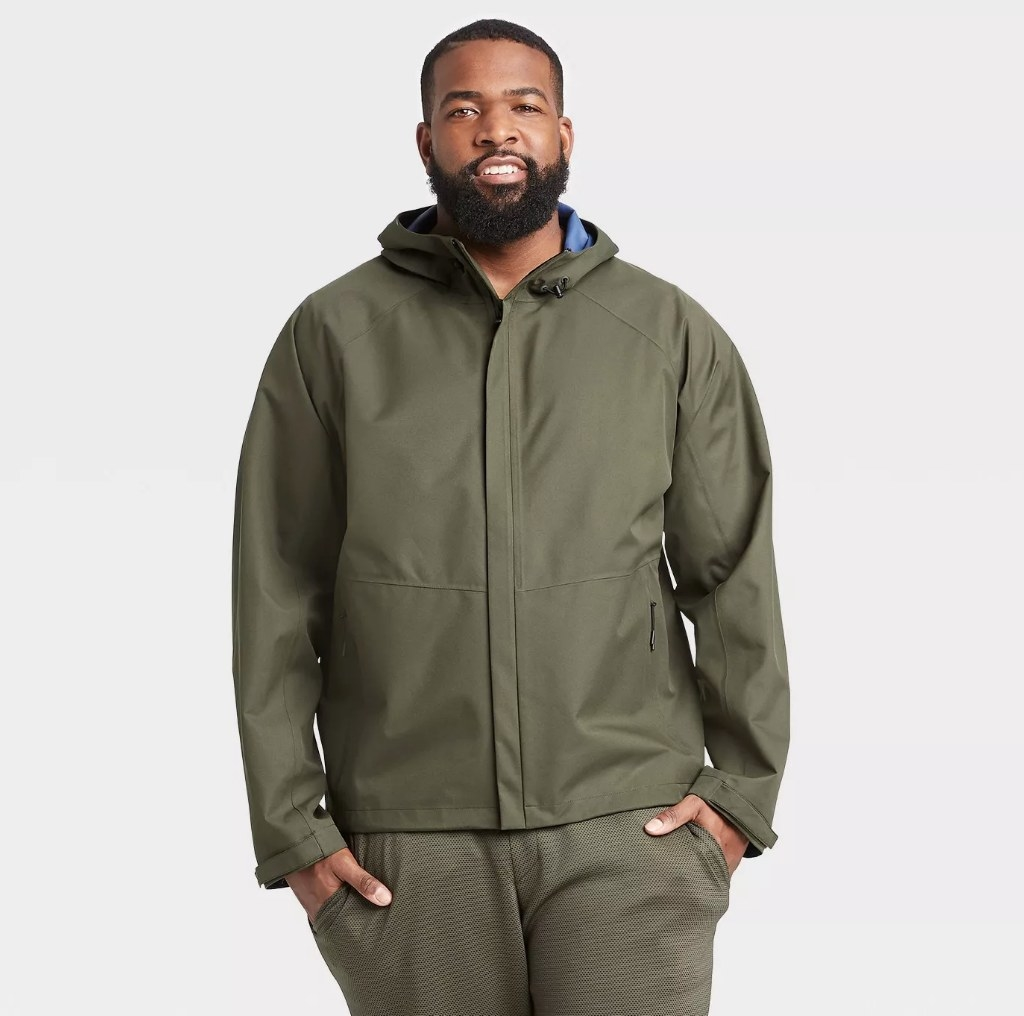 Model wearing green zip up jacket