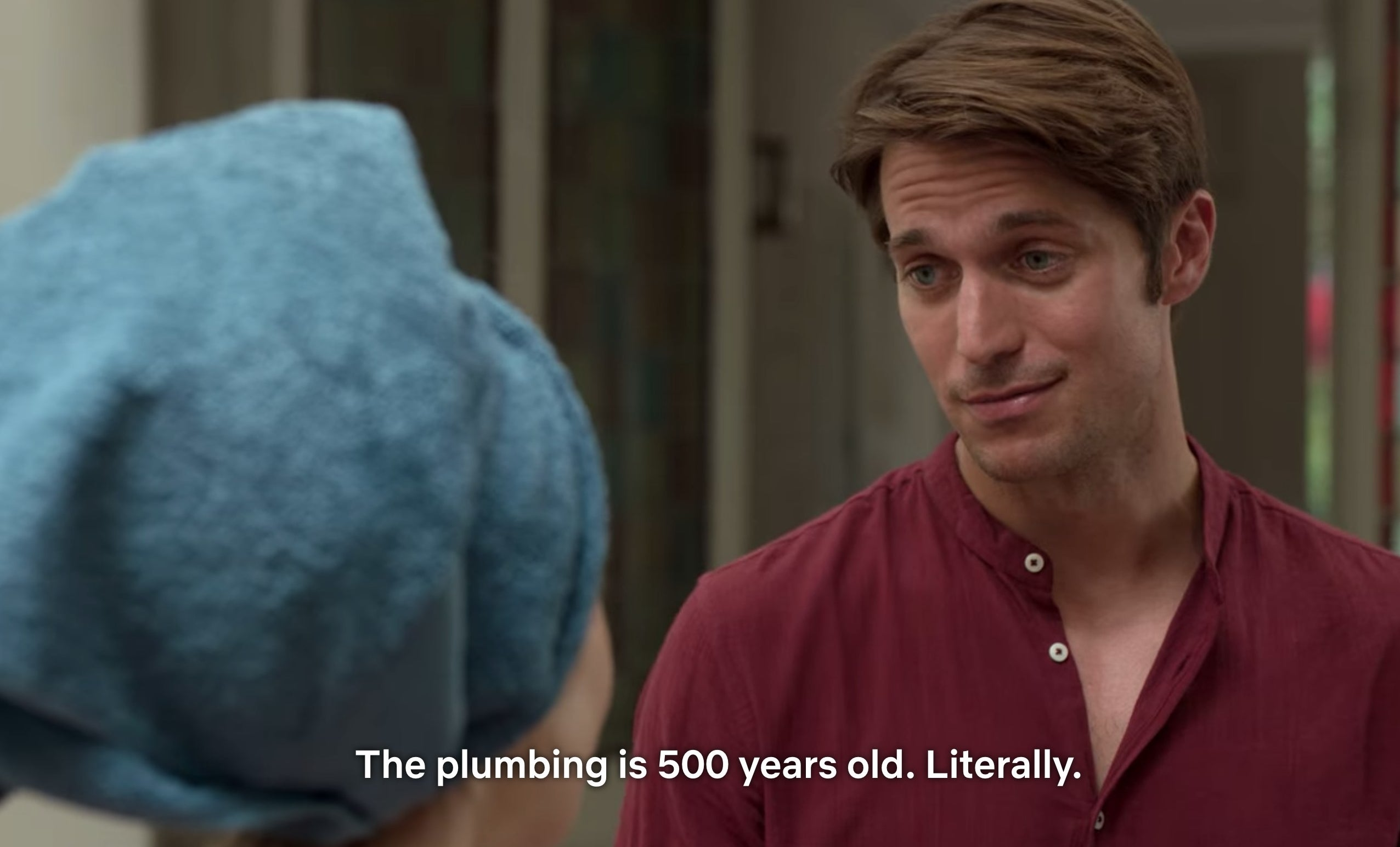 "A scene from Emily in Paris that says ""The plumbing in 500 years old. Literally."""