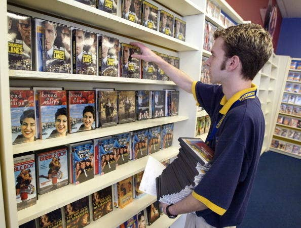 man browsing the blockbuster dvd section