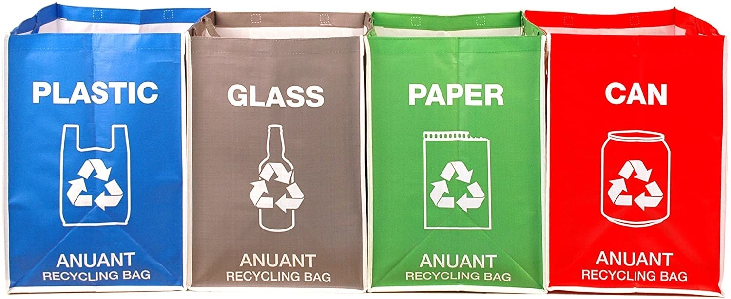 Plastic, glass, paper, and can labeled rectangular containers