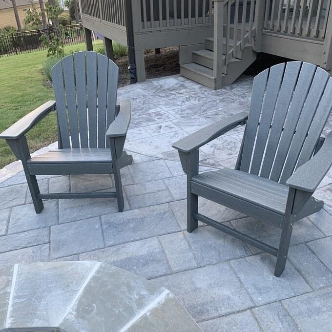 The slate gray Adirondack chairs