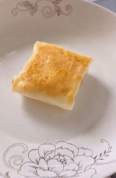 A folded egg envelope with the yolk inside.