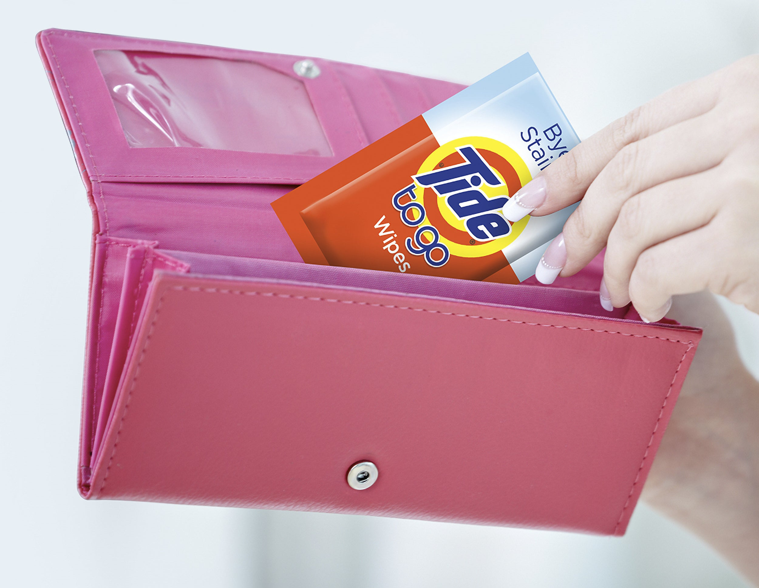 Person putting the wipes in their wallet