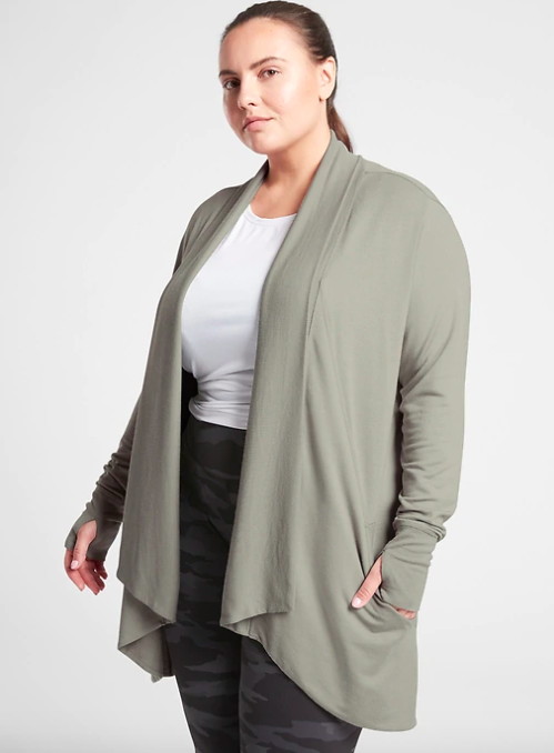 Model wears mint long-sleeve wrap cardigan with white tee and camo print leggings