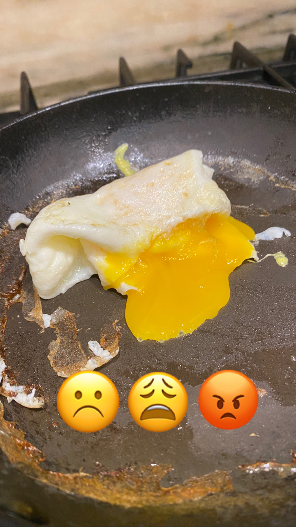 My failed attempt to make an egg envelope with yolk dribbling out onto the pan.