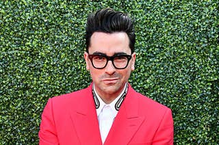 Dan Levy smiling on the red carpet