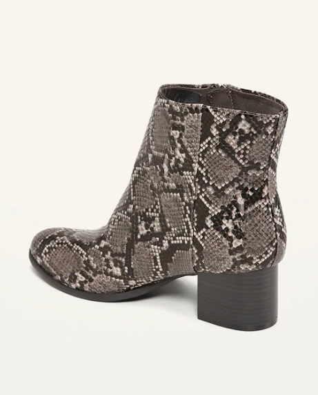 Brown, black, and white faux-snakeskin booties with a dark wood heel