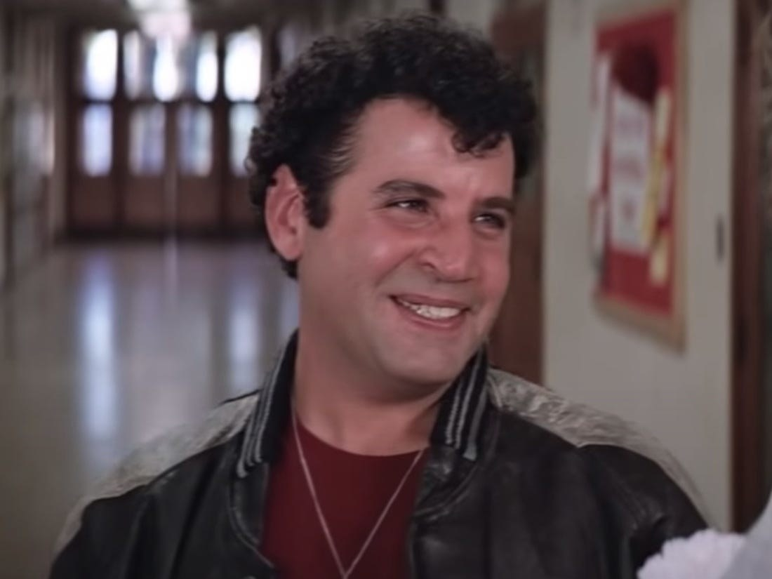 Sonny smirking in the halls of Rydell High.