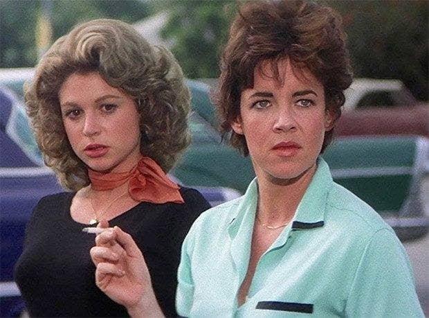 Rizzo smoking a cigarette next to Jan.