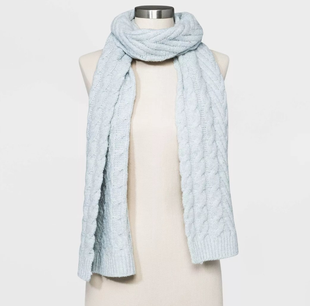 Light blue woven scarf over a mannequin