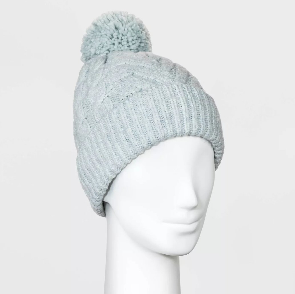 Blue woven beanie with blue pom-pom on mannequin head