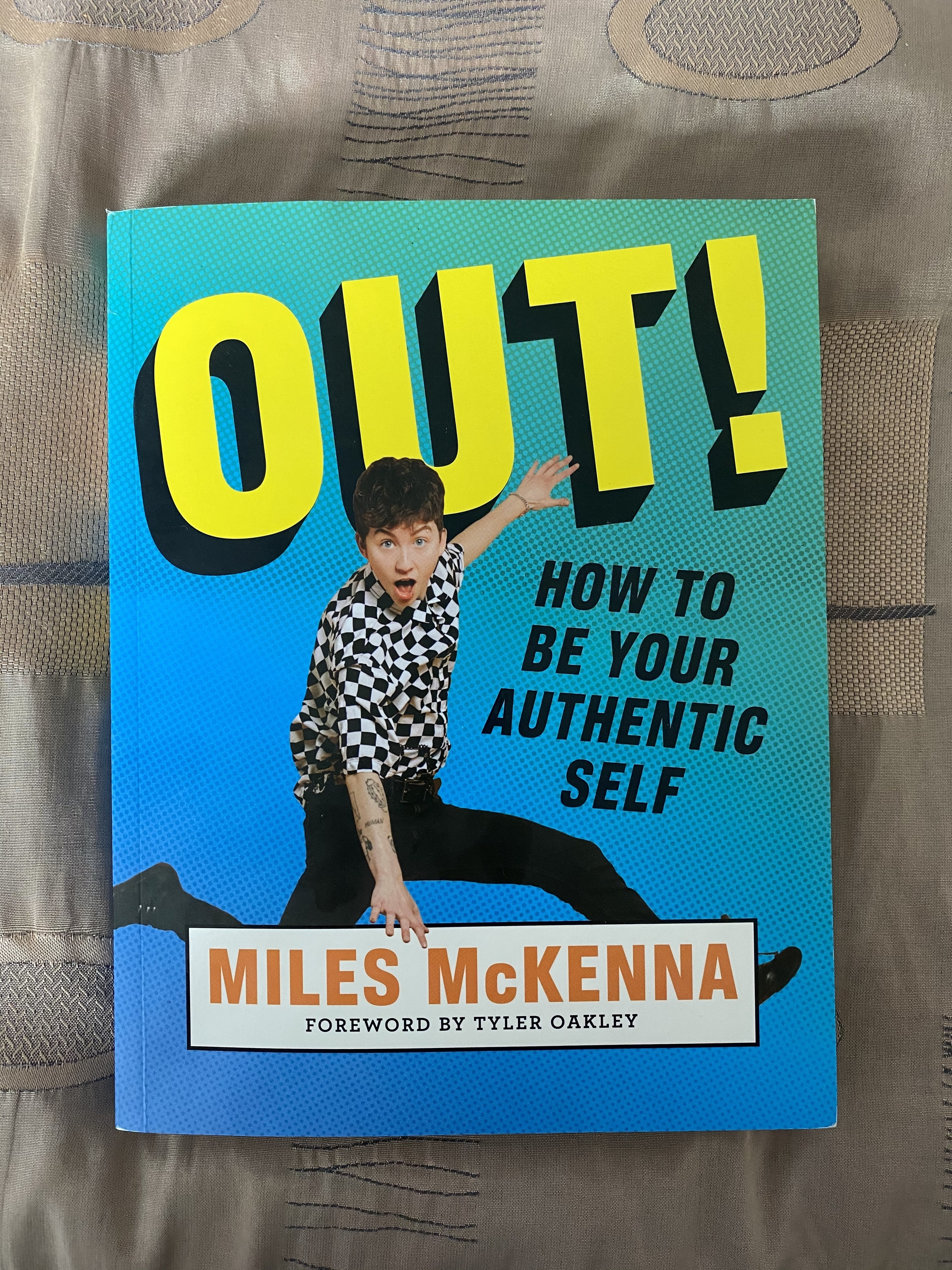 Colourful book with Miles  jumping up excitedly on the cover