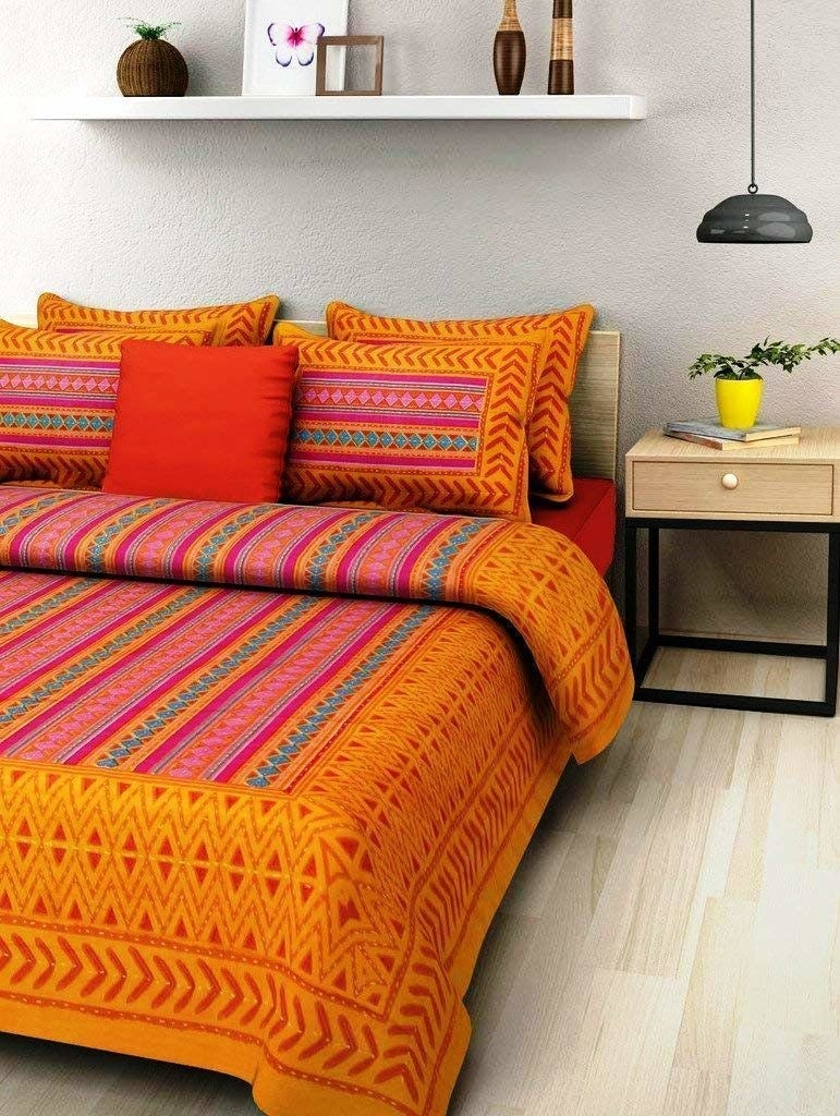An orange and red bedsheet