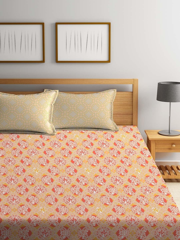 An orange red and beige bedsheet