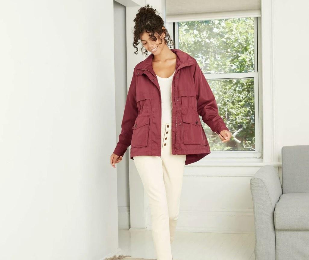 Model wearing maroon cargo raincoat