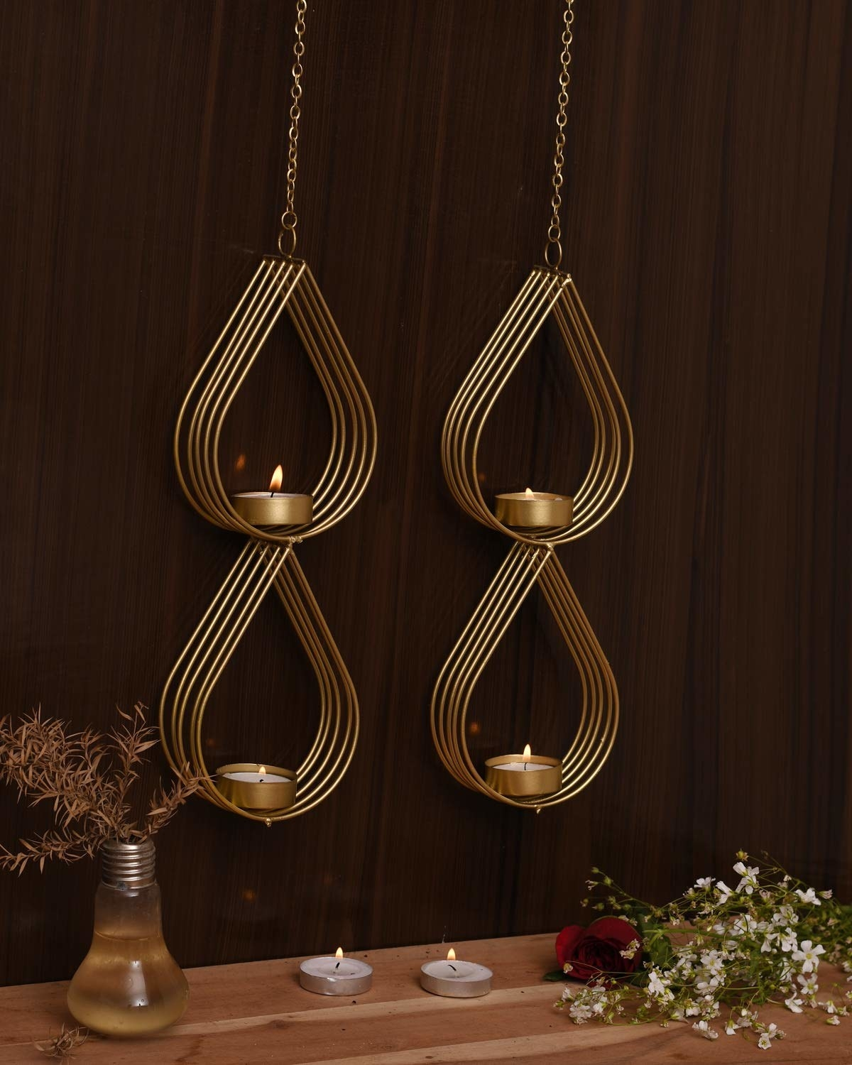 Four teardrop-shaped hanging candle holders.
