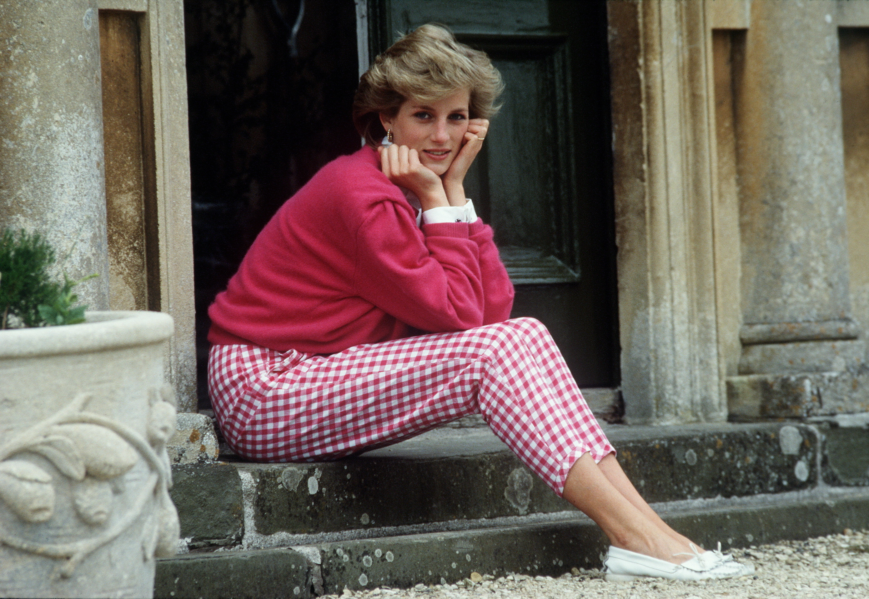 Princess Diana Resting Her Head In Her Hands Whilst Sitting On The Steps Of Her Home At Highgrove