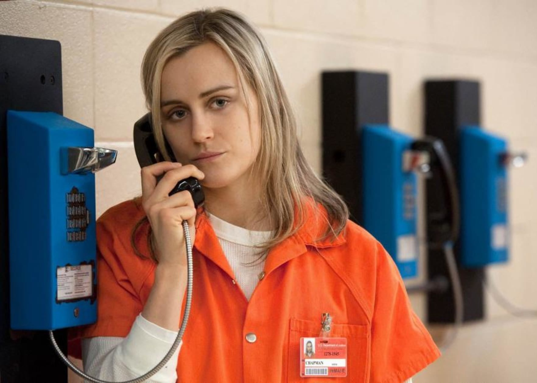 Piper using the payphone while in prison