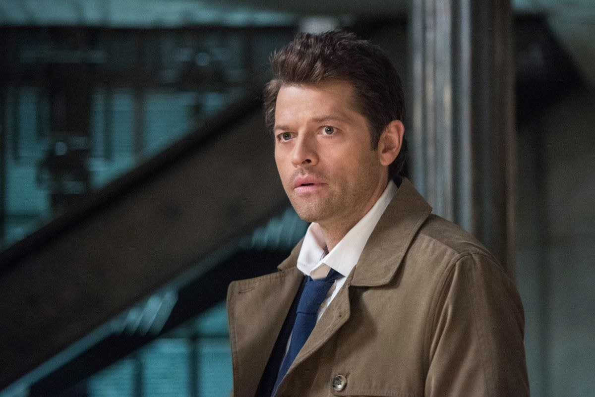 A closeup of Castiel, who is wearing a jacket, white shirt and tie