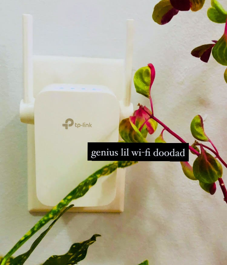 A wi-fi extender plugged into a wall