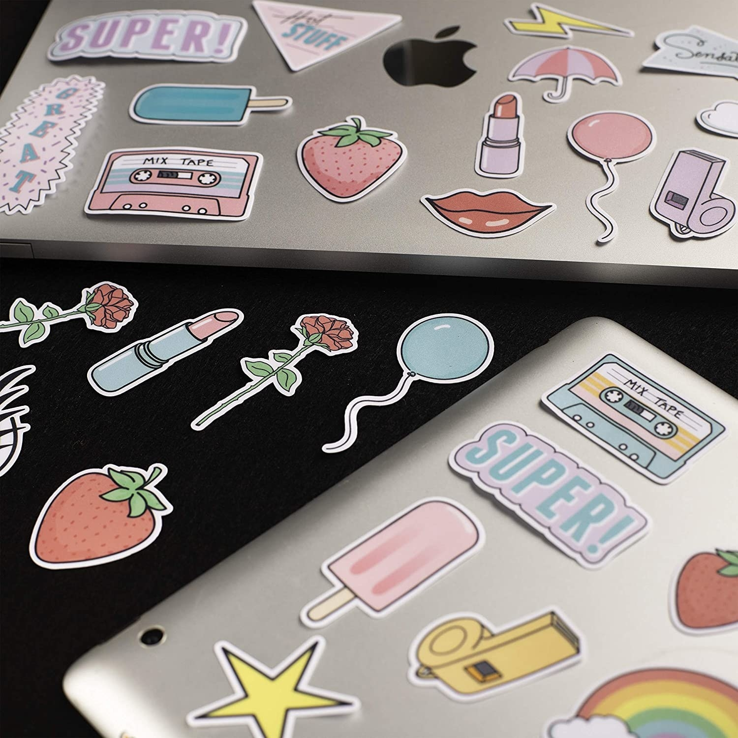 Several stickers on two laptop computers