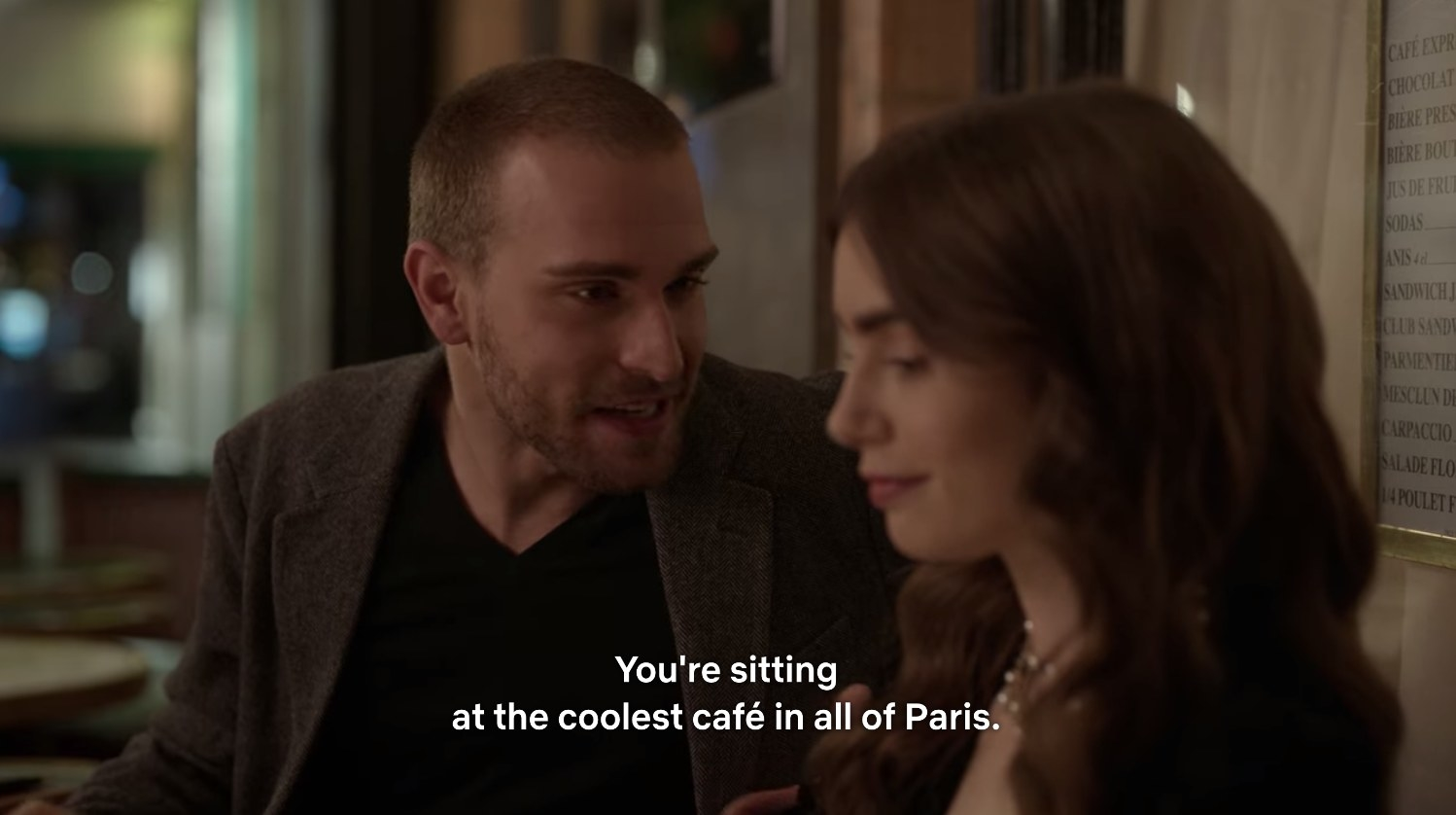 "Emily being told ""You're sitting at the coolest cafe in all of Paris."""
