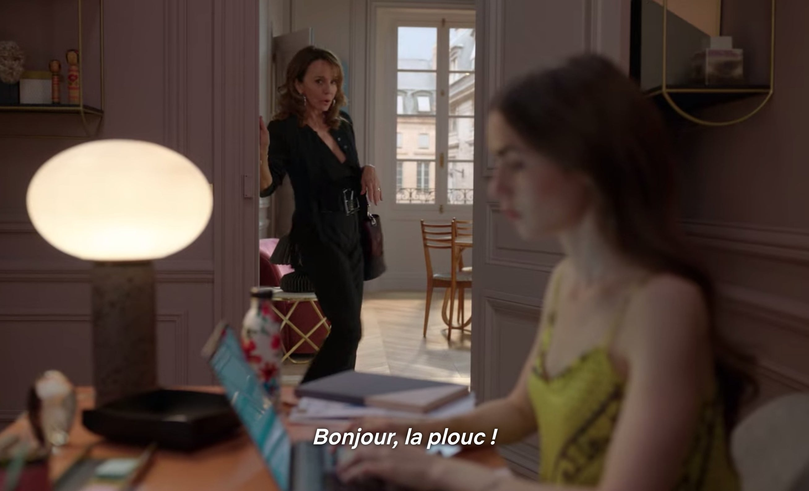 "Emily being greeted at her new job with ""Bonjour, la plouc!"""