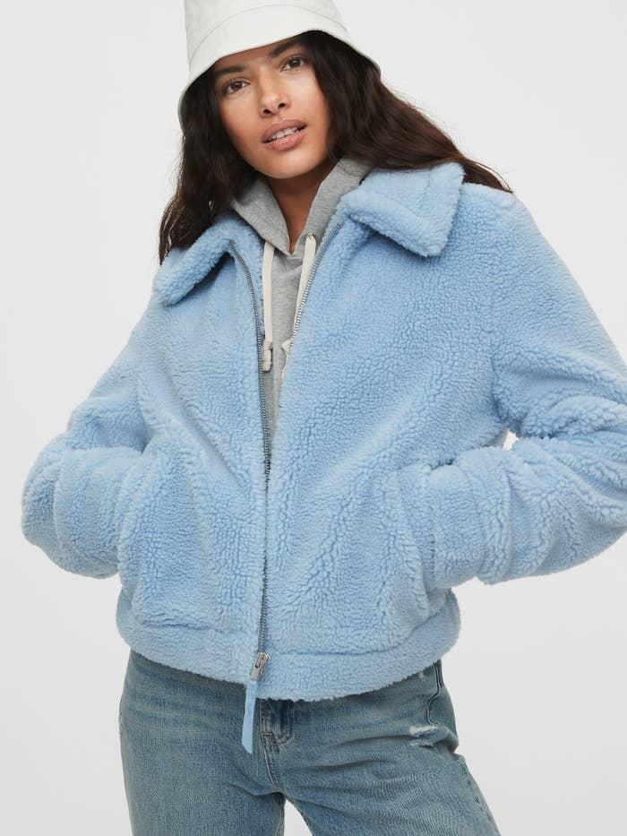model wearing sherpa jacket in light blue