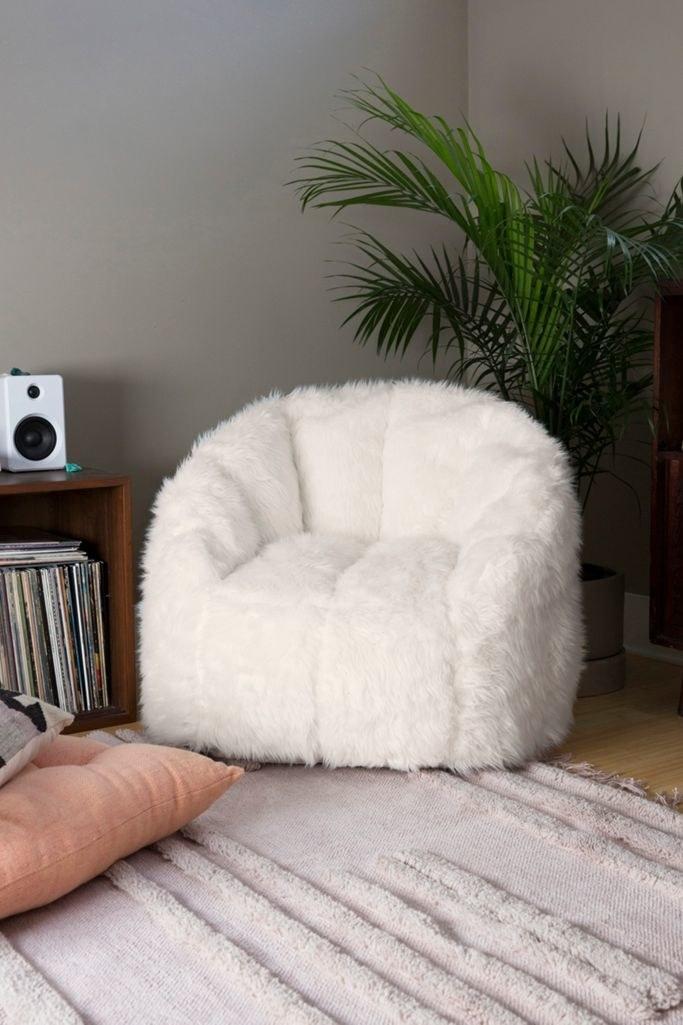 A stout white faux fur chair