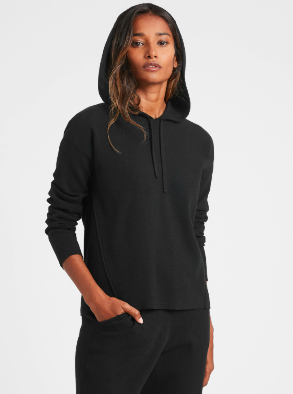 a model wearing the hoodie in black