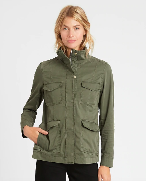 a model wearing the jacket in army green