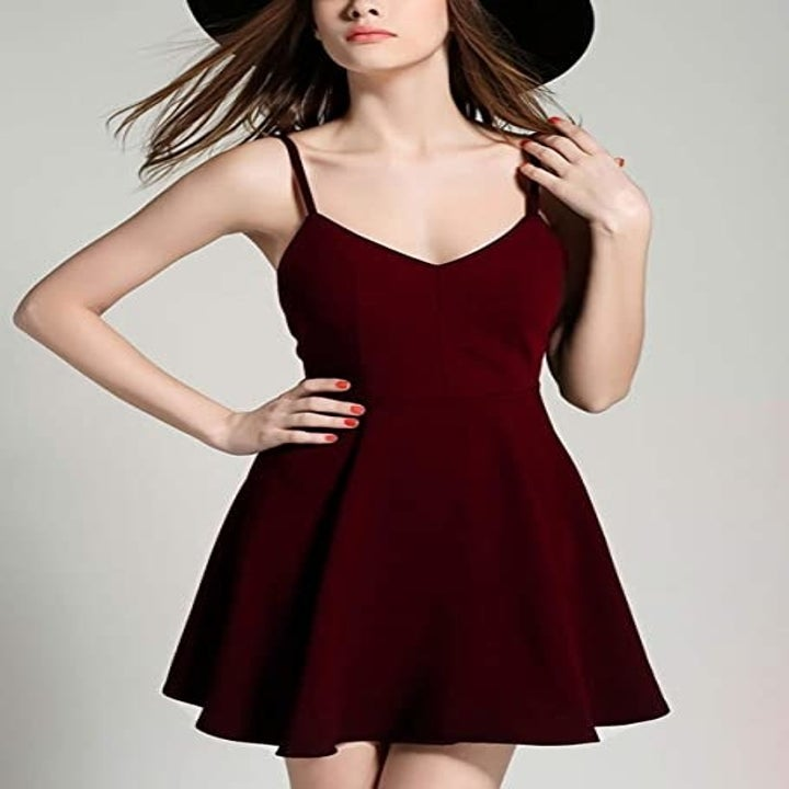 model wearing the dress with spaghetti straps on the front