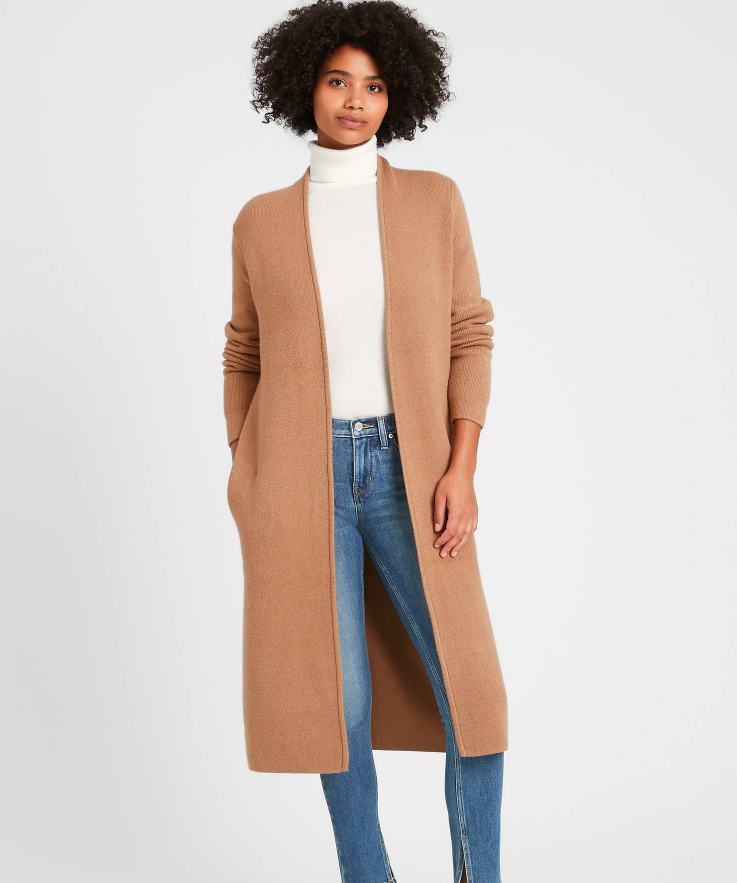 a model wearing the duster in caramel color